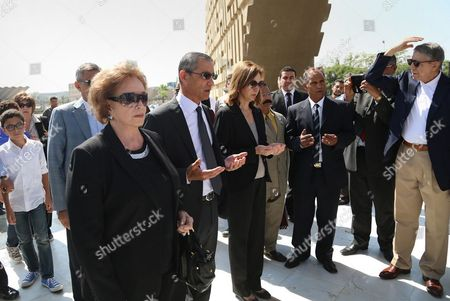 Jehan Sadat, widow of assassinated Egyptian president Anwar Sadat, lays a wreath at his tomb inside the memorial of the Unknown Soldier in Cairo