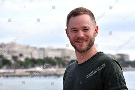 Aaron Ashmore poses for a photocall to present the series 'Killjoys'