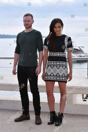 Aaron Ashmore and Hannah John-Kamen pose for a photocall to present the series 'Killjoys'