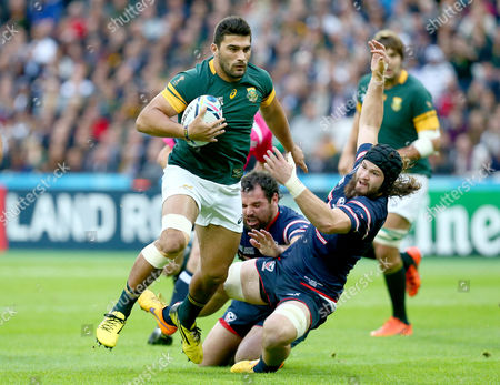 Damian de Allende of South Africa pushes away Daniel Barrett of the USA on his way to scoring the games opening Try.