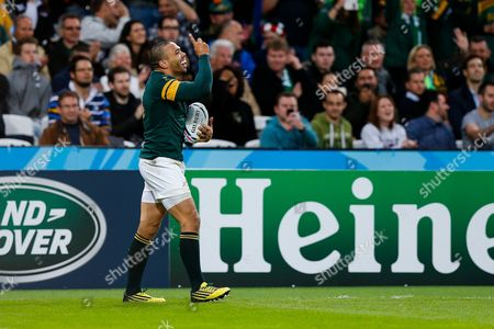 South Africa Winger Bryan Habana celebrates scoring his 3rd try of the match to draw level with Jonah Lomu at the top of the all time list on 15 tries in the Rugby World Cup