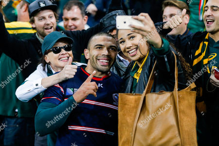 South Africa Winger Bryan Habana takes selfies with supporters after scoring 3 tries in the match to draw level with Jonah Lomu at the top of the all time list on 15 Rugby World Cup tries