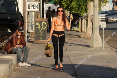 Alicia Arden wears XPOZ jeans with cutouts in the front and back while shopping on Melrose Ave