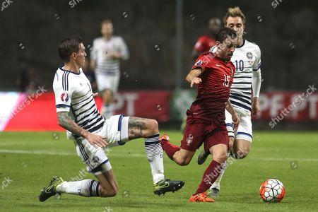 Denmark's defender Daniel Agger and Portugal's defender Bernardo Silva