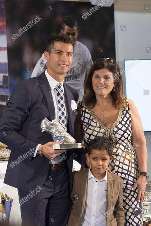 Cristiano Ronaldo poses with his son Ronaldo and his mother Maria Dolores dos Santos Aveiro