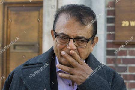 Vinod Hindocha, Anni Dewani's father, listens to a statement being read to the media after leaving North London Coroner's Court