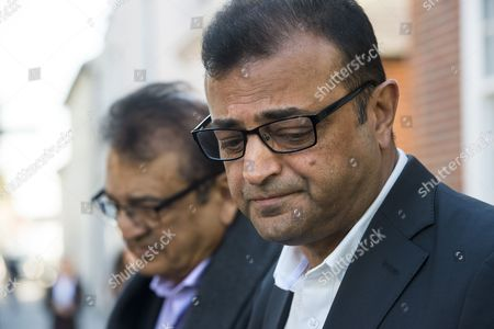 Stock Image of Anni Dewani's father Vinod Hindocha (left) and uncle Ashock Hindocha (right) give a statement to media outside North London Coroner's Court