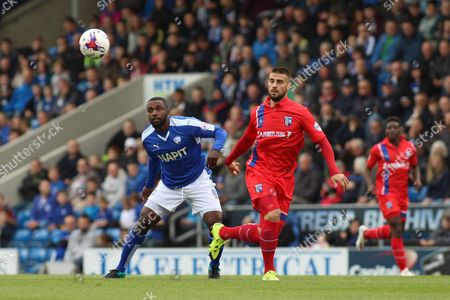 Chesterfield FC forward Sylvan Ebanks-Blake and Gillingham FC defender Max Ehmer challenge for the ball during the Sky Bet League 1 match between Chesterfield and Gillingham at the Proact stadium, Chesterfield