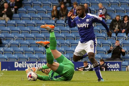 Gillingham FC goalkeeper Stuart Nelson makes a brave save from the attacking Chesterfield FC forward Sylvan Ebanks-Blake during the Sky Bet League 1 match between Chesterfield and Gillingham at the Proact stadium, Chesterfield