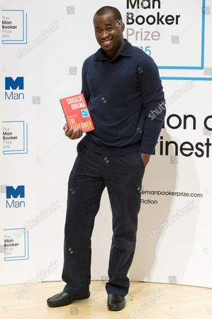 Chigozie Obioma with his book 'The Fishermen'
