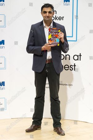 Sunjeev Sahota with his book 'The Year of the Runaways'