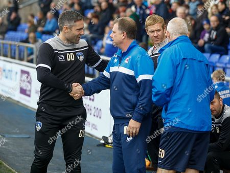 Oldham boss David Dunn speaks to Mark Robins of Scunthorpe