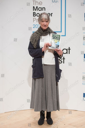 Anne Tyler with her book 'A Spool of Blue Thread'