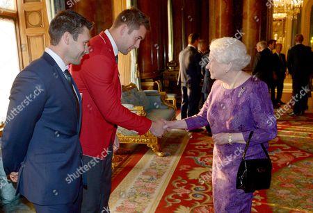 Queen Elizabeth II meets Canada's James Pritchard (left) and Jebb Sinclair (centre)