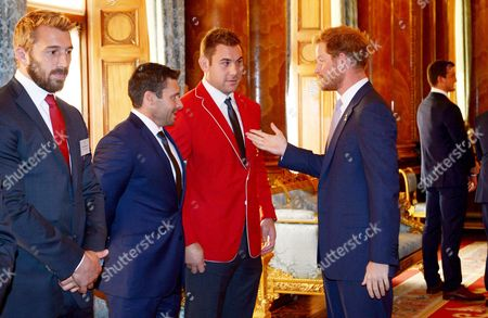 Prince Harry meets Canada's James Pritchard (left) and Jebb Sinclair (centre)