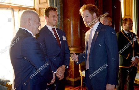 Prince Harry meets Wales' Rugby Union Captain Sam Warburton (second left) and Wales' head coach Warren Gatland (left)