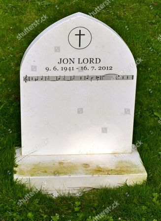 Stock Photo of Jon Lord grave and headstone with the music of Smoke on the Water.