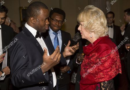 Stock Image of Camilla Duchess of Cornwall speaks with nominated author Chigozie Obioma