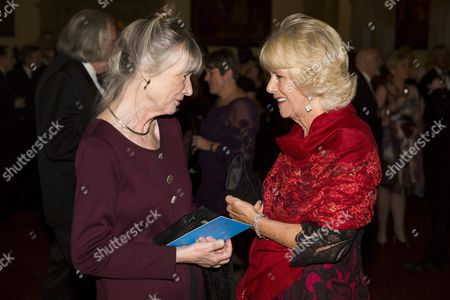 Camilla Duchess of Cornwall speaks with nominated author Anne Tyler (L)