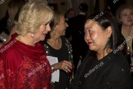 Stock Picture of Camilla Duchess of Cornwall speaks with nominated author Hanya Yanagihara (R)