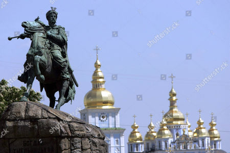 The monument in the centre of St. Sophia Square is an equestrian statue of Cossack leader Bohdan Khmelnytsky (1595-1657) and on the right St. Michael Golden Domed Cathedral in Kiev, Ukraine