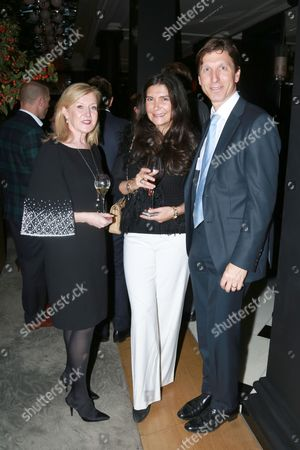 Stock Photo of Louise Kennedy, Sagra Maceira de Rosen & Ian Rosen attends the opening reception for Frieze London in the Mirror Room at Rosewood London in partnership with UTA and Artsy