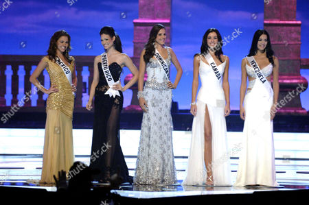 The 5 finalists competing for the title of Miss Universe 2005. From left to right are: Laura Elizondo, Miss Mexico 2004; Cynthia Olavarria, Miss Puerto Rico 2004; Renata Son, Miss Dominican Republic 2004; Natalie Glebova, Miss Canada 2005, and Monica Spear, Miss Venezuela 2005. A panel of distinguished celebrity judges is now determining which contestant will become the 54th Miss Universe at the conclusion of the 2 hour telecast