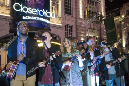 Members of the cast including Stephanie McKeon (Cast) perform in Piccadilly Circus after the curtain call