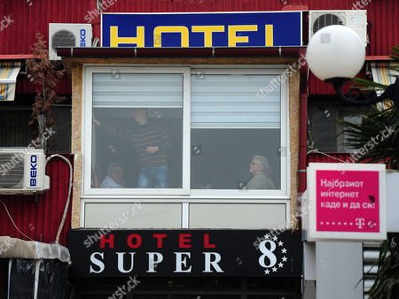Some Hotel Guests Can Be Seen In The Window Where They Are Quarantined In The Hotel Super 8 Skopje Macedonia A British Businessman Who May Have Been Killed By The Ebola Virus In Macedonia Was Vomiting And Shaking For Two Days Before He Died His Travelling Companion Revealed Yesterday. Father-of-three Colin Jaffray 58 Travelled With Business Partner Michael English From The Uk To The Balkan State To Try To Set Up A Fish Farm Business. Health Officials In Macedonia Sparked An International Panic In The Aftermath Of His Death By Claiming He Was Displaying Some Of The Symptoms Of The Disease. But Mr English Said Last Night It Was 'crazy' To Think His Friend Was Suffering From Ebola - Because Mr Jaffray Had Not Travelled To Africa For Six Years. Claims That His Friend Died As A Result Of Drinking Too Much Alcohol Were Also Denied.