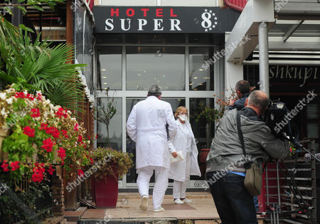 Two Doctors Arrive At The Hotel Super 8 Skopje Macedonia To Carry Out Tests On The Guests Inside After A British Hotel Guest Dies Of Suspected Ebola The Remaining Guests Are Kept In The Hotel In Quarantine For 48hrs. A British Businessman Who May Have Been Killed By The Ebola Virus In Macedonia Was Vomiting And Shaking For Two Days Before He Died His Travelling Companion Revealed Yesterday. Father-of-three Colin Jaffray 58 Travelled With Business Partner Michael English From The Uk To The Balkan State To Try To Set Up A Fish Farm Business. Health Officials In Macedonia Sparked An International Panic In The Aftermath Of His Death By Claiming He Was Displaying Some Of The Symptoms Of The Disease. But Mr English Said Last Night It Was 'crazy' To Think His Friend Was Suffering From Ebola - Because Mr Jaffray Had Not Travelled To Africa For Six Years. Claims That His Friend Died As A Result Of Drinking Too Much Alcohol Were Also Denied.