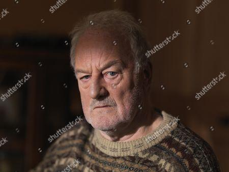 Bernard HilL as Father Robert Greaves.
