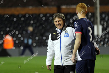 Newcastle Under 21 Manager, Peter Beardsley shares  a joke with Liam Gibson during Fulham U21 vs Newcastle United U21 at Craven Cottage, London