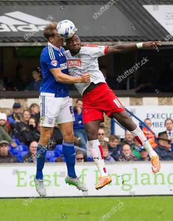 Christophe Berra, Ipswich Town and Ishmael Miller, Huddersfield Town challenge for aerial ball during Ipswich Town vs Huddersfield Town at Portman Road, Ipswich