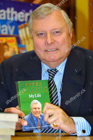 Peter Alliss, five times Ryder Cup player, BBC and ABC television commentator and author of books on golf, signing copies of his autobiography 'My Life'