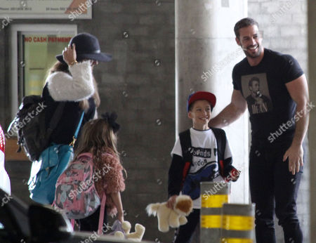 Editorial picture of Elizabeth Gutierrez and William Levy at Cape Town Airport, South Africa - 14 Oct 2015