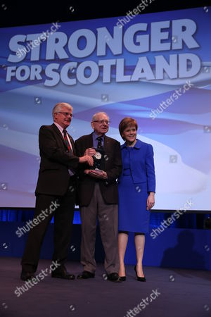"""SNP National Conference - Ian Hudghton MEP, and President of the SNP, presents the President's Prize to Jim Lynch, editor of """"Scots Independent"""" newspaper, and Nicola Sturgeon MSP, Party Leader and First Minister of Scotland"""