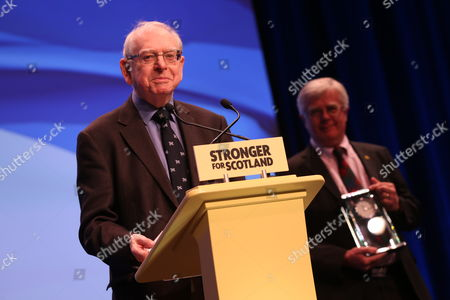 """SNP National Conference - Jim Lynch, editor of """"Scots Independent"""" newspaper addresses conference having just received the President's Prize from Ian Hudghton MEP, and President of the SNP"""