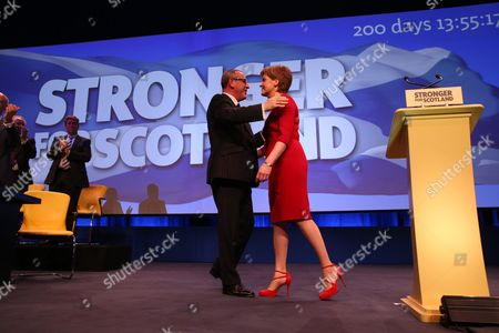 Nicola Sturgeon MSP, Party Leader and First Minister of Scotland, after delivering her Leader's Speech, is congratulated by Stewart Hosie MP (Dundee East), Deputy Leader of the SNP and SNP Westminster Group Leader (Economy)