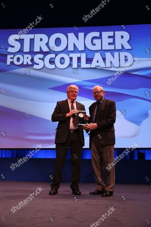 """SNP National Conference - Ian Hudghton MEP, and President of the SNP, presents the President's Prize to Jim Lynch, editor of """"Scots Independent"""" newspaper"""