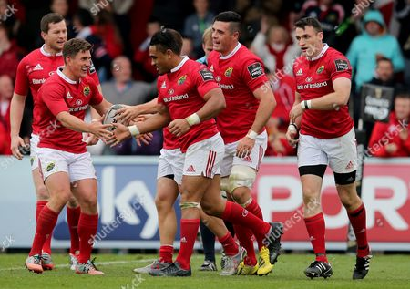 Stock Photo of Munster's Andrew Conway celebrates his try with Jordan Coghlan, Shane Monahan, Francis Saili and Ian Keatley