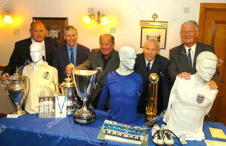 Pic Shows...Everton FC launch their Charitable trust Fund of historic Football memorabilia to raise £1.2 Million pounds. Pictured here is Director Keith Wynass (Far Left), Lord Grantchester (Second from left), Howard kendall (Middle), Peter Reid (Second from right) and Legend Brian labone (Far right)...with some of the fanous Memorabilia...See Mercury Copy © Mercury Press Agency Ltd. (MPA) This image is copyright. MPA Rate Card reproduction rates apply. Call 0151 236 6707 for details. Not for electronic publication on the internet or other similar formats without agreement on fee.  Electronic library storage and retrieval is authorised by publishers to whom the material has been supplied by the Copyright owner.