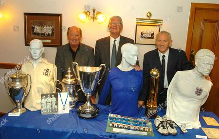 Pic Shows...Everton FC launch their Charitable trust Fund of historic Football memorabilia to raise £1.2 Million pounds. Pictured here is Everton legends Howard kendall (Left), Brian labone (Middle) and Peter Reid (Right)...with some of the fanous Memorabilia...See Mercury Copy © Mercury Press Agency Ltd. (MPA) This image is copyright. MPA Rate Card reproduction rates apply. Call 0151 236 6707 for details. Not for electronic publication on the internet or other similar formats without agreement on fee.  Electronic library storage and retrieval is authorised by publishers to whom the material has been supplied by the Copyright owner.