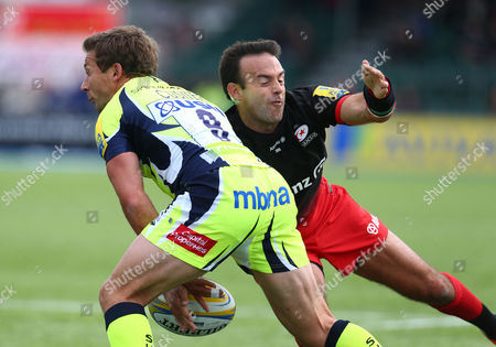 Stock Photo of Neil De Kock of Saracens tackles Chris Cusiter of Sale.