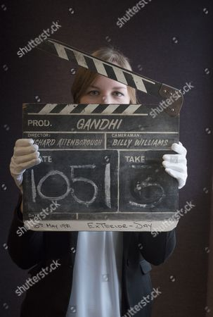 A wooden clapperboard used during the production of Ghandi est. £2,000-3,000