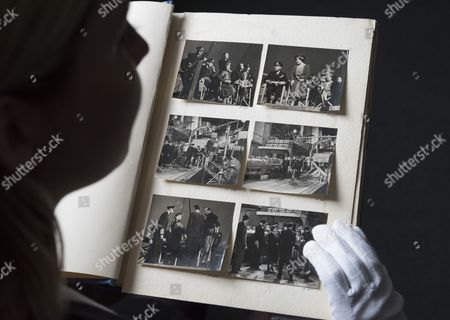 An album of photographs (est. £8,000-12,000) including  Queen Elizabeth 1 and the then Princess Elizabeth visiting the set of 'In Which We Serve' 1942