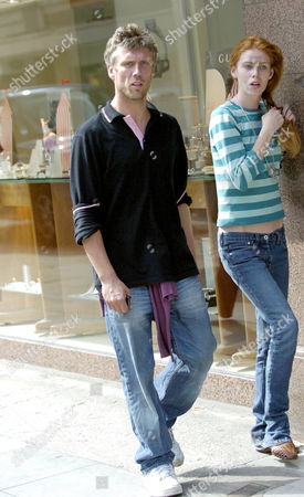 Bez, real name Mark Berry, looks far from happy as he walks through Manchester City Centre with girlfriend Monica Ward.