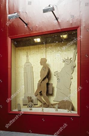 Site fence with art in shop window, wooden figure by conceptual artist Hans-Peter Feldmann, Luis Vuitton Store, Koenigsallee, Duesseldorf, North Rhine-Westphalia, Germany, Europe