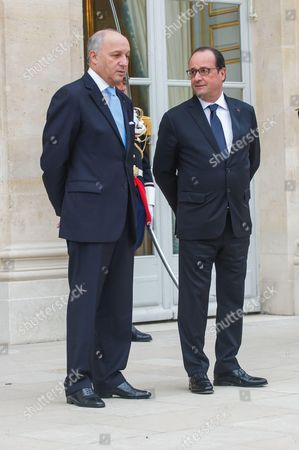 French President Francois Hollande (R) and French Foreign Minister Laurent Fabius after a meeting with Kuwait's Prime Minister Sheikh Jaber Al Mubarak Al Hamad Al Sabah at the Elysee Palace