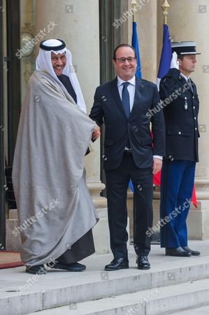 French President Francois Hollande shakes hand with Kuwait's Prime Minister Sheikh Jaber Al Mubarak Al Hamad Al Sabah for a meeting at the Elysee Palace