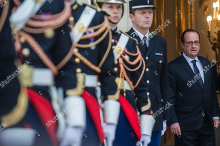 French President Francois Hollande see Kuwait's Prime Minister Sheikh Jaber Al Mubarak Al Hamad Al Sabah to the door after a meeting at the Elysee Palace